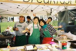 volunteer at farmers' market in Oakland